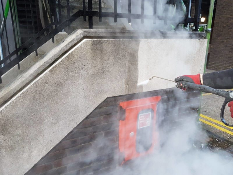 DOFF steam cleaning of exterior building staircase