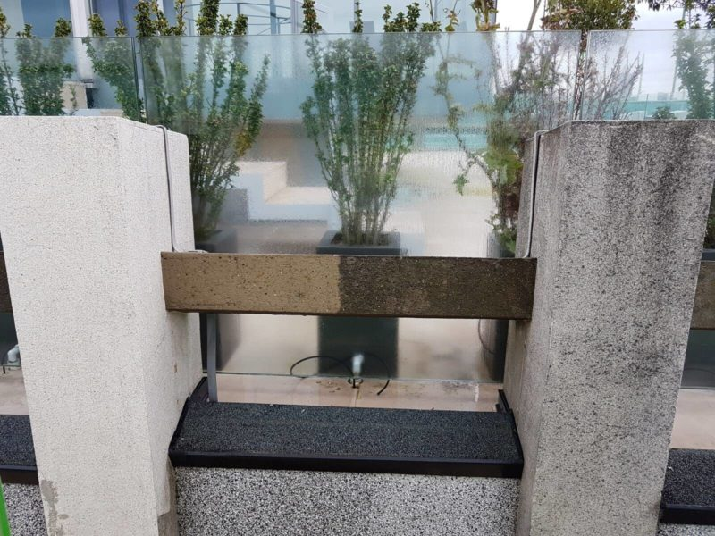DOFF steam cleaning before and after on external concrete wall