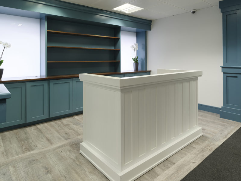 Blue and white decorated reception area of Mayfair office