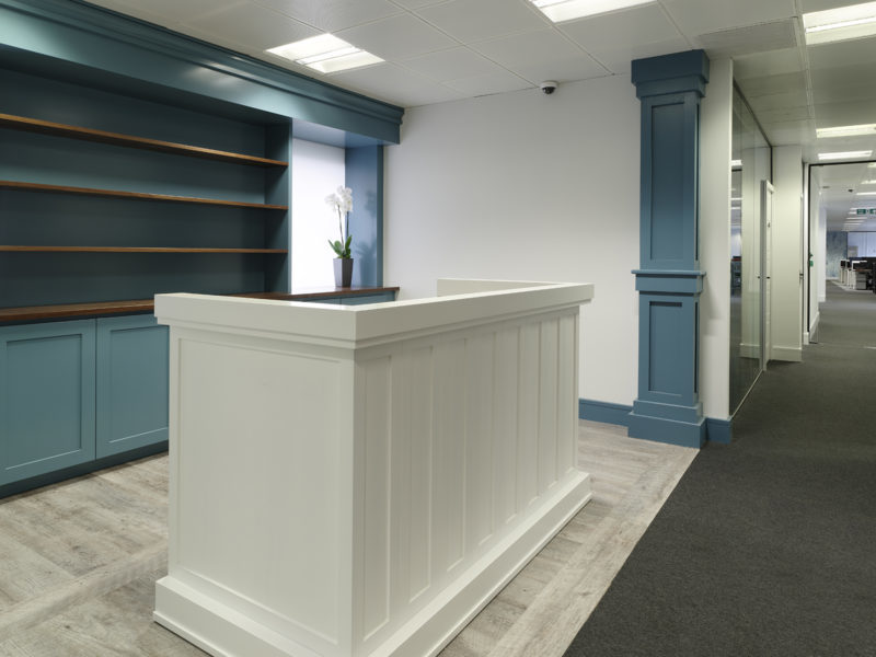 Blue and white office entryway in Mayfair