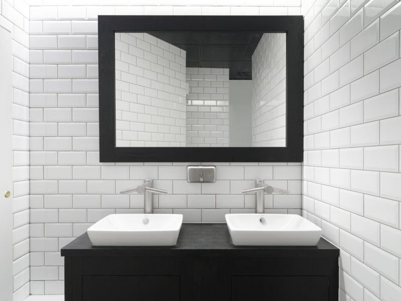 Sparkling white sinks in a toilet in Mayfair offices
