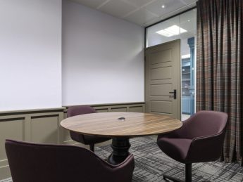 Table and chairs in a breakroom in Mayfair office