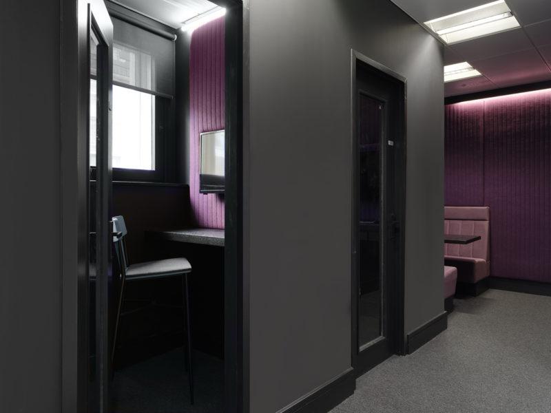 Purple booths in a Mayfair office in London