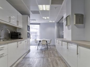 Shining white kitchen in newly fitted out Mayfair office