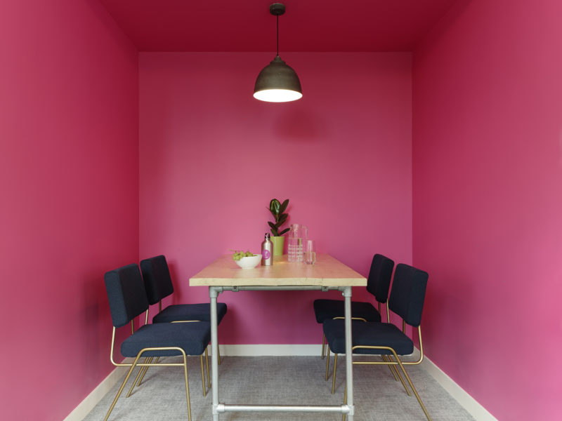 Office breakout area with pink walls