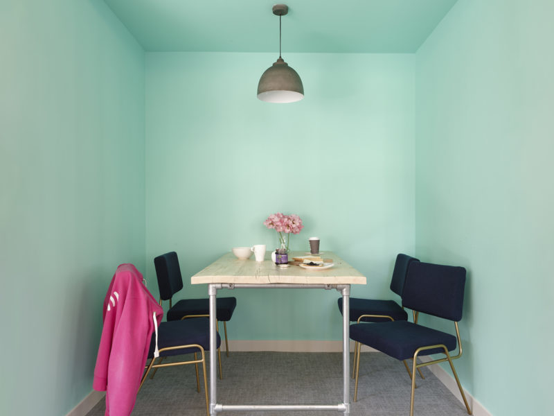 Office breakout area with blue walls