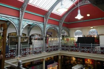 Interior of Camden Lock Market with red ceiling and intricate balcony